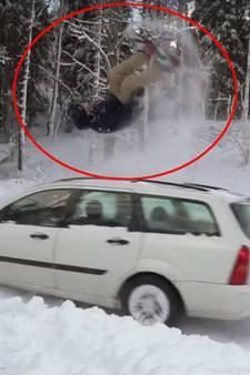VIDEO: Backflip met snowboard over rijdende auto