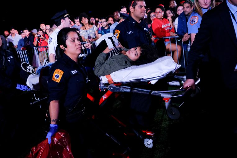 A woman who was overrun is taken away injured.