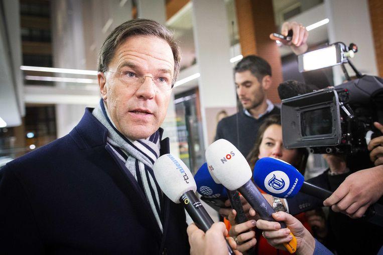 Premier Rutte verlaat  het ministerie van sociale zaken en werkgelegenheid na het pensioenoverleg met werkgevers en vakbonden zonder akkoord. Beeld Evert-Jan Daniels, ANP