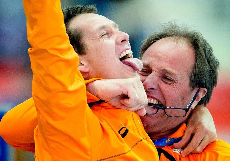 Kampioenen Jac Orie met olympisch kampioen Stefan Groothuis (Sotsji, 2014). Beeld ANP