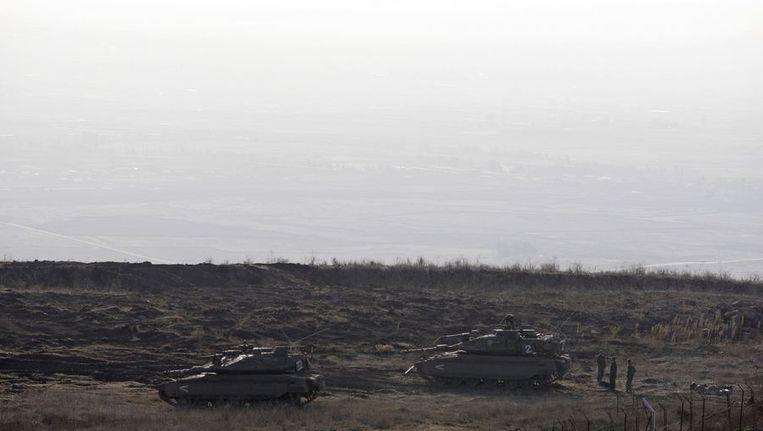 Israelische tank bij de grens van Syrië. Beeld reuters