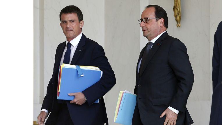Frans president Francois Hollande (R) en eerste minister Manuel Valls.