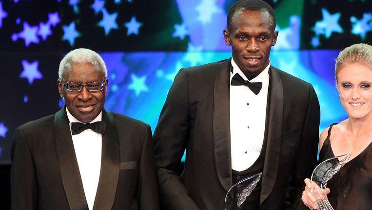 Lamine Diack, enkele jaren terug naast Usain Bolt.