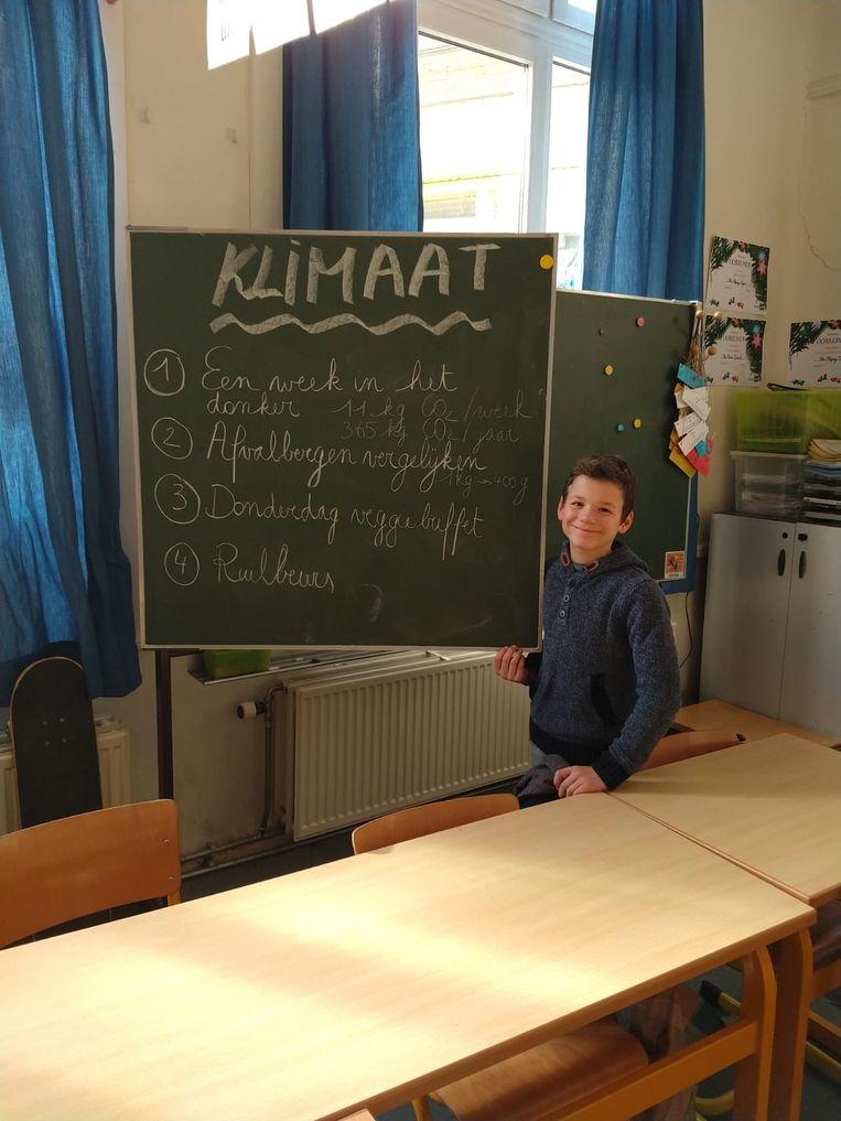Een leerling tijdens de klimaattop.