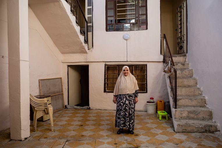 De herstelde huizen in West-Mosul zijn fris beige gestuct.  Beeld Hawre Khalid
