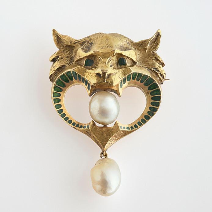 Juweel van René Lalique uit circa 1905: goud, parels en email.