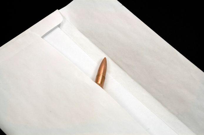 De hoofdbeklaagde probeerde een andere beklaagde te intimideren met een kogel in een enveloppe