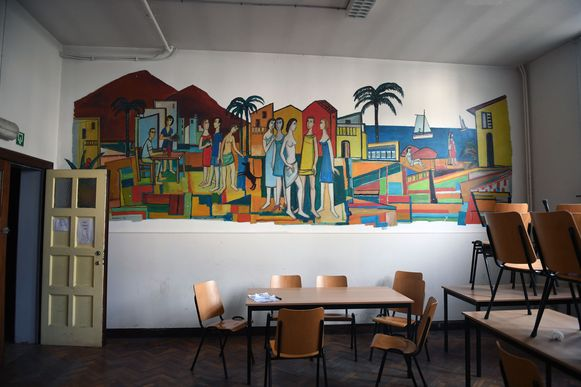 De waardevolle muurschildering van Theo Humblet in de oude brandweerkazerne.