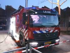 Gevel huizencomplex in brand in 1e Lulof Dwarsstraat