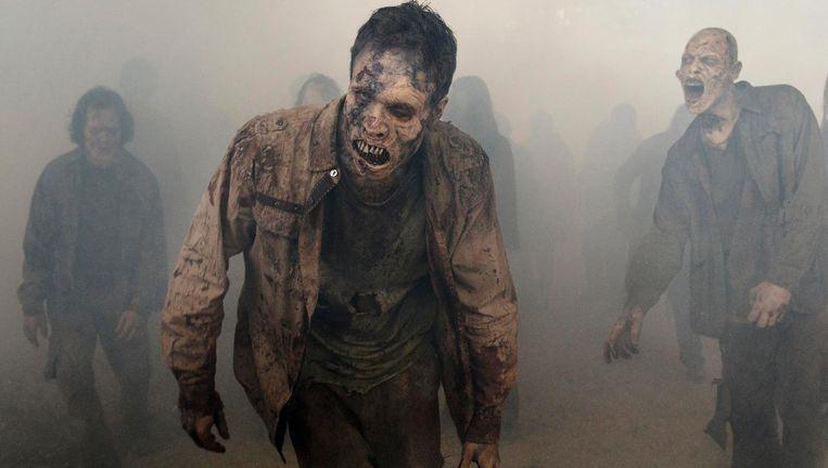 In The walking dead moeten de laatste mensen overleven in een wereld vol zombies Beeld Gene Page/AMC