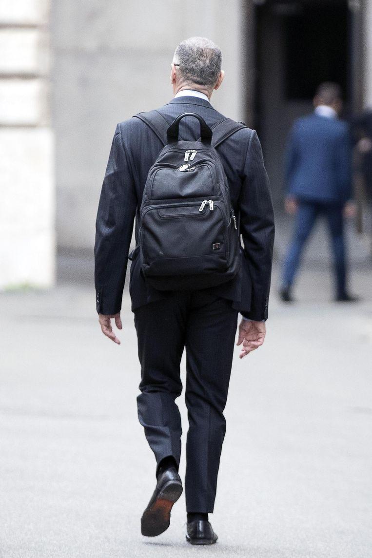 In pak met rugzak, on-Italiaans. Beeld EPA