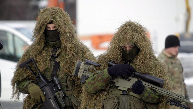 Litouwse soldaten namen vorige week deel aan een welkomstceremonie voor een Navo-bataljon dat in hun land wordt gestationeerd. Beeld EPA