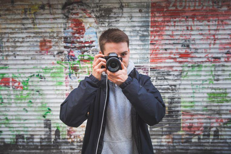 fotograaf met fotoboek over Gent