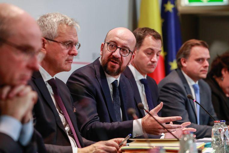 De Belgische premier Charles Michel geeft een persconferentie met het nieuwe kabinet op 9 december. Beeld EPA