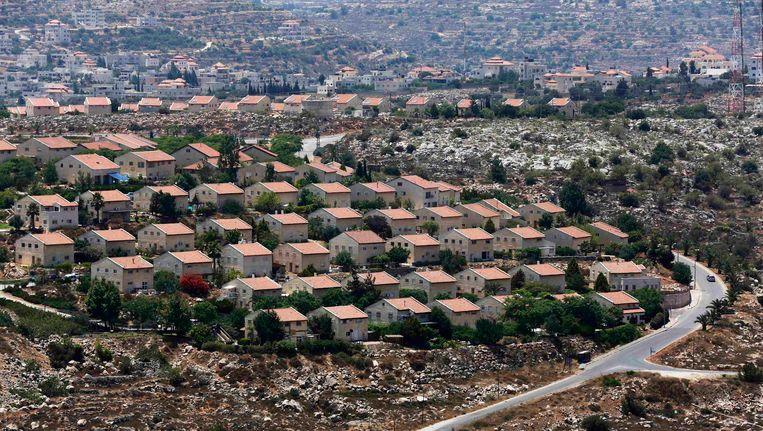 Israëlische huizencomplexen op Palestijns gebied, vlakbij Ramallah. Beeld REUTERS