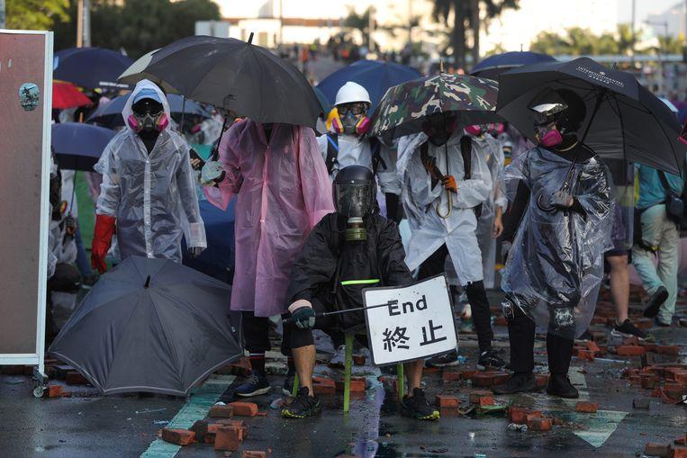De 24-jarige student Glass in Hongkong: 'Nee, dit is geen protest meer. Dit is een revolutie.' Beeld EPA