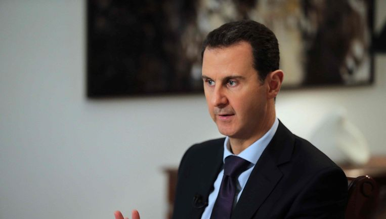 Assad tijdens het interview met AFP in Damascus. Beeld afp