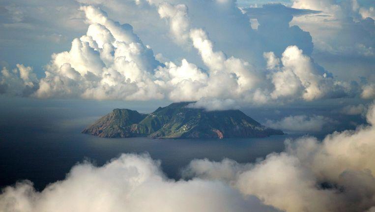 'Met 877 meter hoogte is de Mount Scenery op Saba de hoogste plek in het Koninkrijk der Nederlanden. In het tropische woud op de rug van de berg groeien met mos beladen bergmahoniebomen, bromelia's, levermossen, epifyten, zeldzame orchideeën en andere bloeiende planten' Beeld ANP