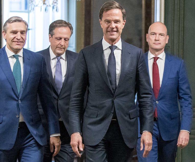 De onderhandelaars Sybrand Buma (CDA), Alexander Pechtold (D66), Mark Rutte (VVD) en  Gert-Jan Segers (ChristenUnie) bij de presentatie van het regeerakkoord.   Beeld ANP