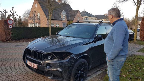 Willy bij zijn deels gestripte BMW X6 in de Salm Salmstraat. De dader sloeg ook toe in de Heidries.