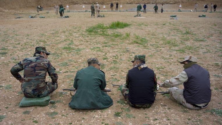 Koerdische Peshmerga-strijders in Erbil, Irak. Beeld anp