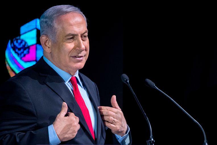 Premier Benjamin Netanyahu van Israël, hier aan het woord tijdens een conferentie in Tel Aviv op 14 februari 2018, wordt aangeklaagd om corruptie. Beeld AFP