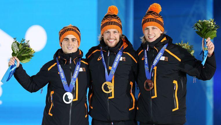 Het volledig Nederlandse podium bij de 500 meter van de mannen op de Winterspelen in Sotsji met Jan Smeekens (links), Michel Mulder (midden) en Ronald Mulder (rechts). Beeld epa