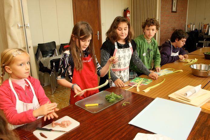 Illustratiebeeld- Kinderen zullen kunnen kiezen uit verschillende activiteiten zoals koken.