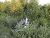 Auto over de kop op A58 onder Breda, bestuurster ongedeerd