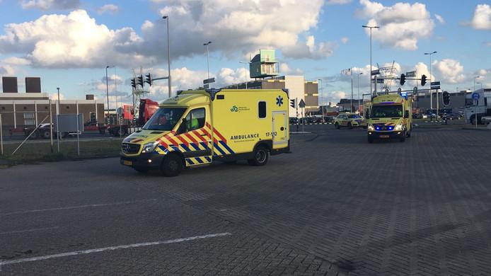Ambulances drive onto the terrain.