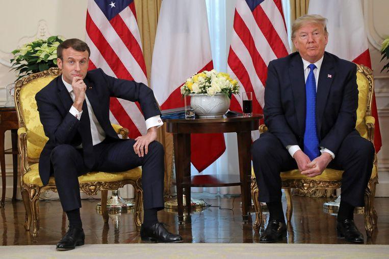 De Amerikaanse president Donald Trump en zijn Franse collega Emmanuel Macron voorafgaand aan de Navo-top in Londen.  Beeld AFP