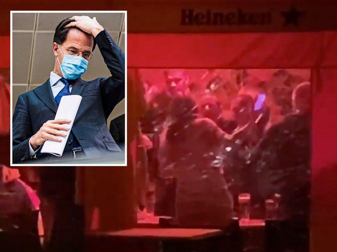 Feestvierders lapten gisteravond de regels massaal aan hun laars bij een 'go out with a bang'-feestje in Den Haag. Inzet: Mark Rutte.