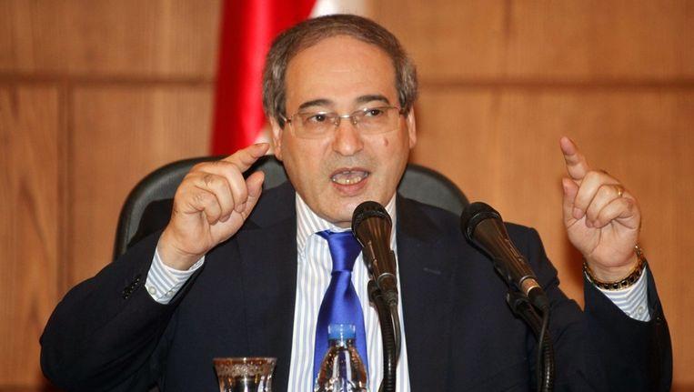 Faisal Mekdad, de Syrische onderminister van Buitenlandse Zaken, vandaag tijdens een persconferentie. Beeld epa