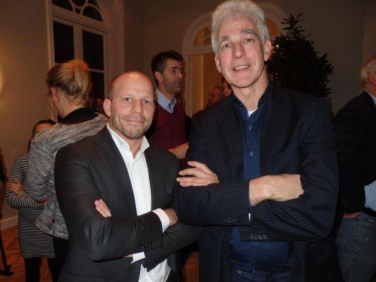 Adverteerders. David Gans van assurantiekantoor Gans van Duivenbode en Ernst Koot van de Plus Supermarkt Beeld Schuim