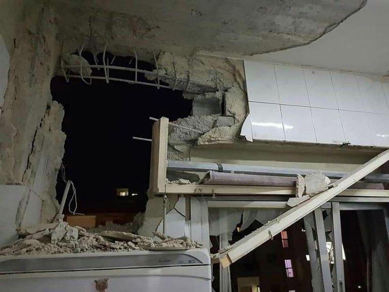 Schade veroorzaakt door de aanval. De foto komt van het Syrische staatspersbureau SANA. Beeld EPA
