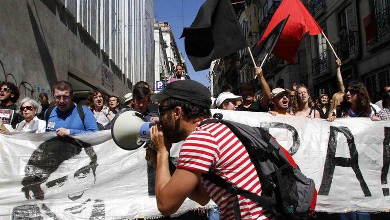Protest tegen de hoge werkloosheid in Lissabon, eind juni. Beeld Reuters