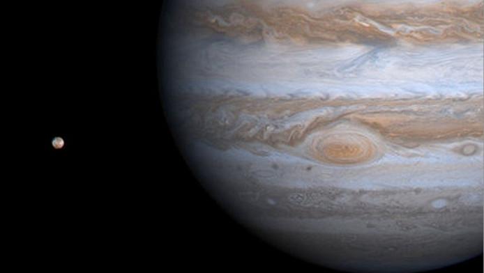 Jupiter en één van zijn manen. Archieffoto. © EPA