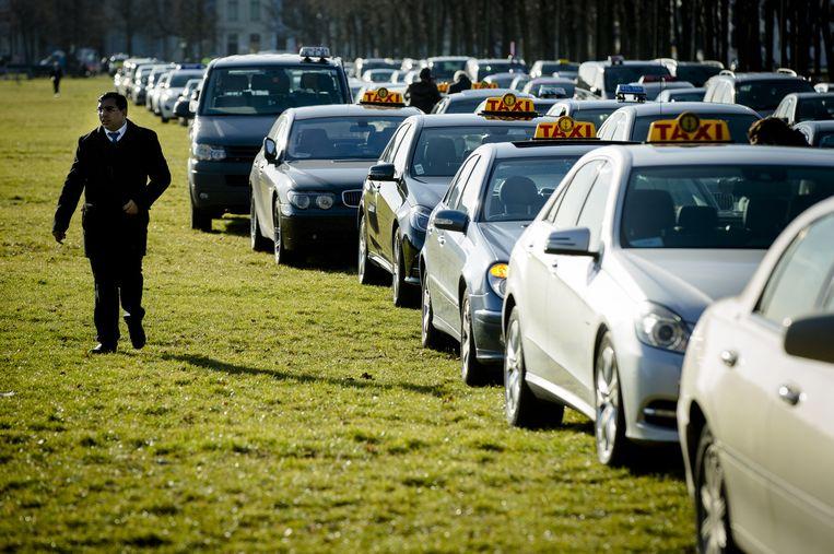 Protest van taxichauffeurs in Den Haag tegen UberPOP, half februari. Beeld anp