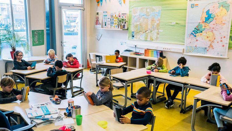 Groep 4 van de Merkelbachschool in Zuid: samen spreken deze kinderen meer dan tien talen Beeld Marcel Wogram