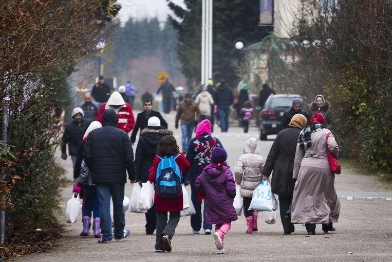 Vluchtelingen in het dorp Oranje. Beeld anp
