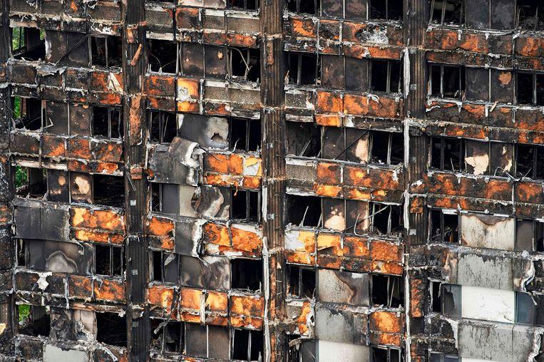 De overblijfselen van de Grenfell Tower in Londen, die eerder deze maand volledig afbrandde. Beeld AFP