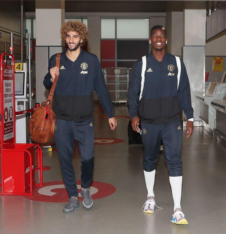 Fellaini en Pogba op Manchester Airport voor het vertrek naar Bern, waar Man United vanavond Champions League speelt.