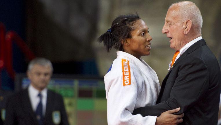 Anicka van Emden samen met haar coach Chris de Korte. Beeld anp