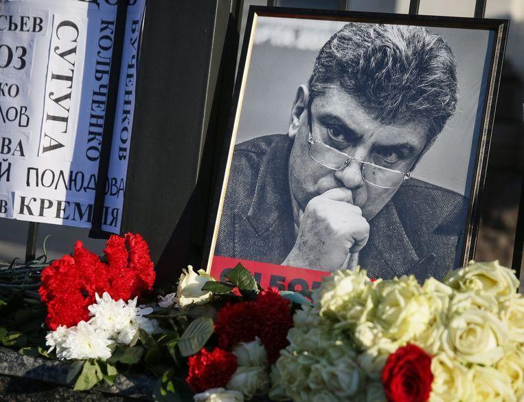 Een portret van Boris Nemtsov een jaar na de moord, bij een herdenking in februari 2016. Beeld epa