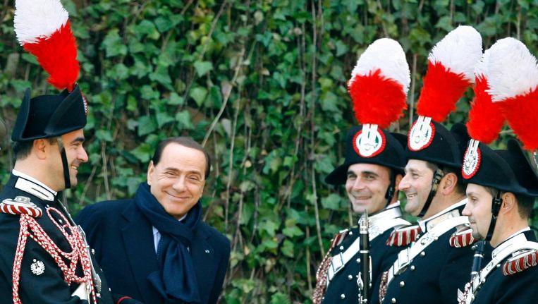 Berlusconi in 2009 in Rome, terwijl hij wacht op de komst van het Zweedse koningshuis. Beeld null
