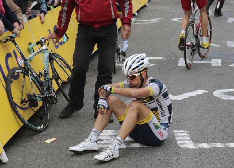 Marco Marcato in Vacansoleil-tenue, na een valpartij tijdens de Tour de France van 2012. Beeld afp