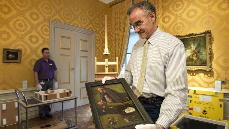 Het nieuw ontdekte schilderij De Verzoeking van de heilige Antonius uit Kansas City van Jheronimus Bosch wordt voor het eerst getoond tijdens een presentatie vandaag. Beeld anp