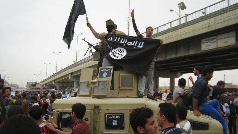 Strijders van terreurbeweging Islamitische Staat (IS) in Fallujah (Archiefbeeld maart 2014) Beeld ap