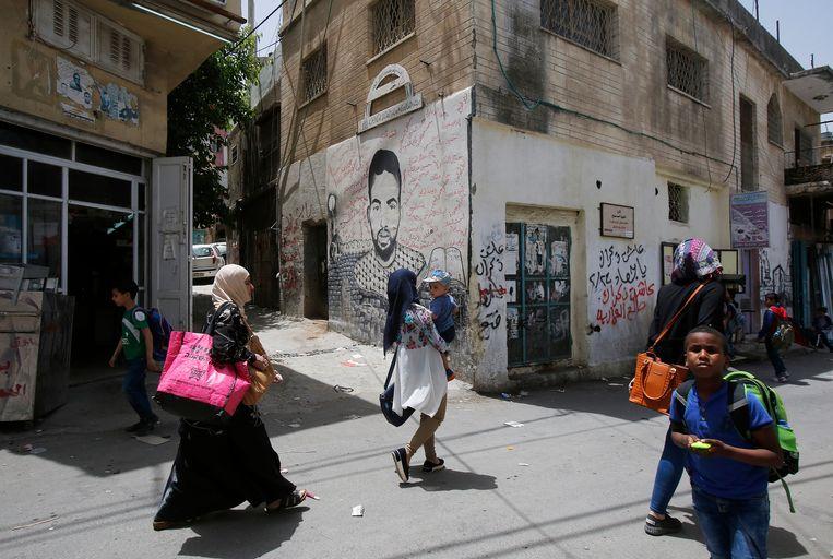 In het Palestijnse vluchtelingenkamp Dheishe herinnert graffiti aan de geschiedenis. Beeld ANP