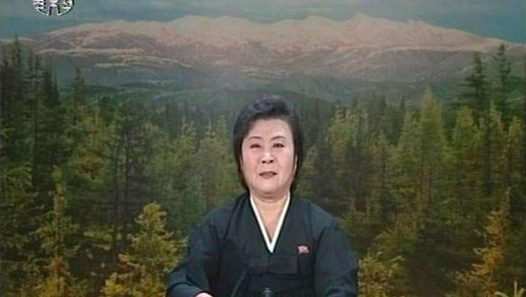 De aankondiging van de dood van Kim Jong-il op de staatszender gebeurde door een snikkende nieuwslezeres. Beeld Reuters